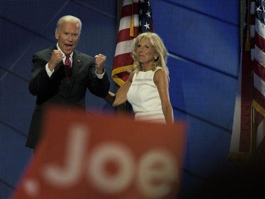 Vice President Joe Biden, seen with his wife Jill Biden, raises his fists as the crowd cheers on Day 3 of the Democratic National Convention.