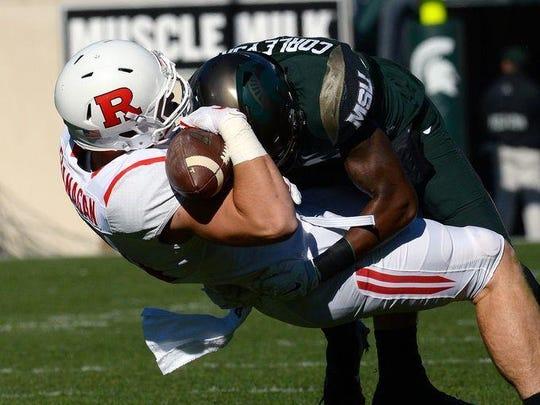 Michigan State Spartans freshman Donnie Corley lays a big hit on Rutgers tight end Matt Flanagan in the first half at Spartan Stadium on Nov. 12, 2016.