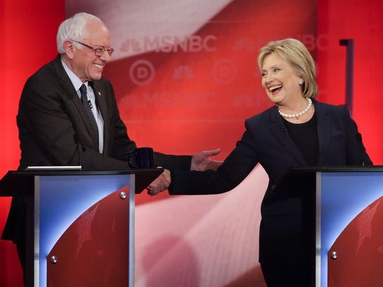 Sen. Bernie Sanders and Hillary Clinton shake hands during a Democratic presidential primary debate. (Photo: David Goldman, AP)