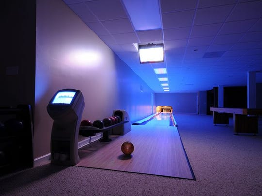 1A Maple Leaf Drive, Holmdel, has a bowling alley.