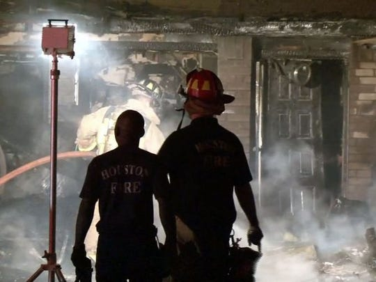 A fire destroyed a garage, and damaged a car and home in Texas. No injuries were reported.