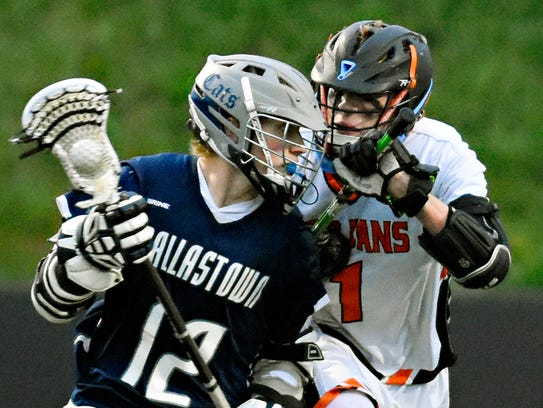 Dallastown's Tanner Haines, left, works to get around York Suburban's Bryce Gavin last season. Haines was a second-team all-county midfielder last season, scoring 40 goals with 19 assists. YORK DISPATCH FILE PHOTO