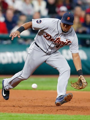 Tigers third baseman Jeimer Candelario fields and throws out Indians third baseman Yandy Diaz at first base during the third inning on Monday, Sept. 11, 2017, in Cleveland.