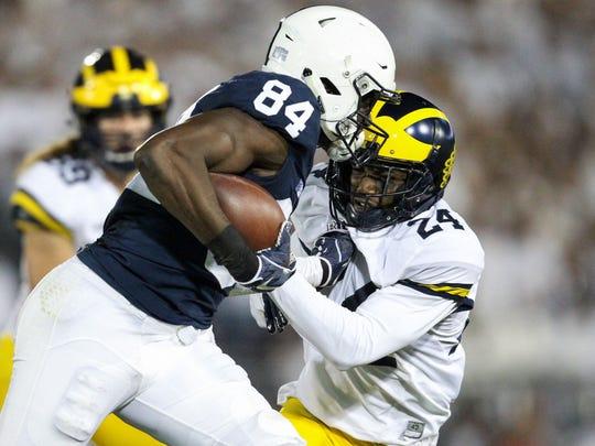 Michigan's Lavert Hill attempts to tackle Penn State's Juwan Johnson last year.