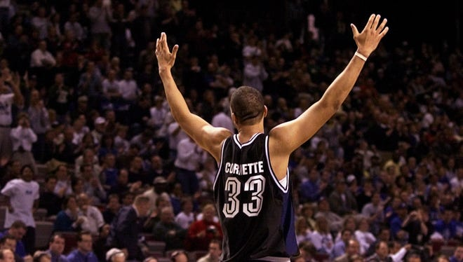 3/16/01.  Butler's Joel Cornette acknowledges the Butler crowd near the end of action vs. Wake Forest.  Butler won 79-63.  NCAA first Round action Kemper Arena Kansas City.  (Robert Scheer Photo) w/story file 57247.