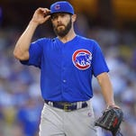 Chicago Cubs starting pitcher Jake Arrieta tips his hat after finishing the seventh inning of a baseball game against the Los Angeles Dodgers, Sunday, Aug. 30, 2015, in Los Angeles. (AP Photo/Mark J. Terrill)