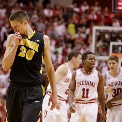 Iowa's Jarrod Uthoff (20) wipes his face during the