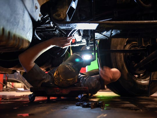Diesel technician Ryan Schusted gets a truck prepped