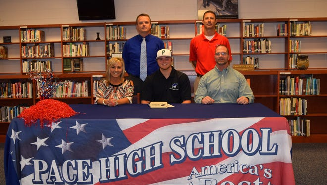 Pace High baseball standout Jake Nemith signed to play at Pensacola State College. Joining him in the Pace Media Center for the signing were his parents, Jena and Chris Nemith. In the back are Pace principal Stephen Shell and Patriots baseball coach Jason McBride.