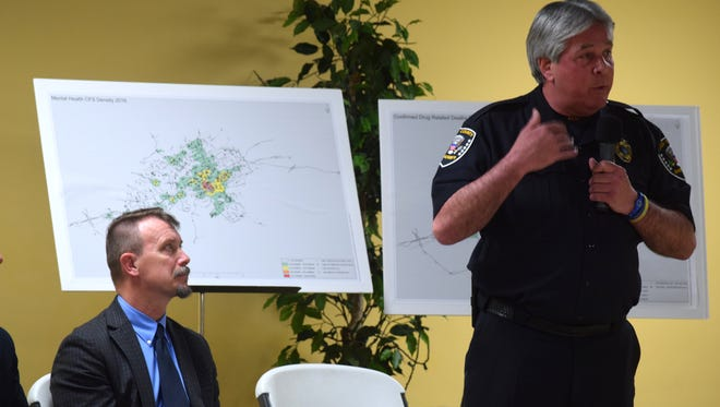 Helen Ross McNabb CEO Jerry Vagnier looks on as Knox County Sheriff J.J. Jones addresses safety concerns regarding a proposed mental health facility for pre-arrest diversion.