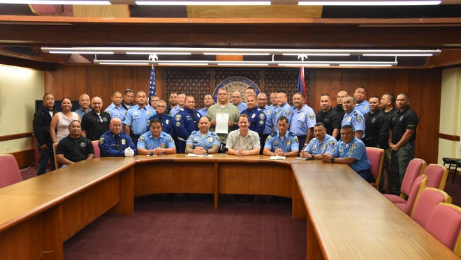 Lt. Gov. Ray Tenorio, Guam Police Department Chief Joseph Cruz and police officers come together in support of the proclamation signing for Police Week at Adelup on May 12, 2017.