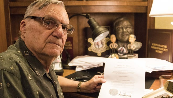 Former Maricopa County Sheriff Joe Arpaio with his pardon from President Trump on Aug. 25, 2017.