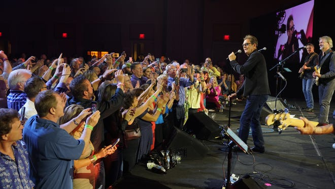 Cell phone cameras were held high as Huey Lewis closes the 4-hour Rheneypalooza Jam on Friday night of The Warburton with his signature horns and harmonica.