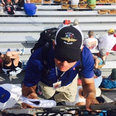 IMS Radio Network reporter, Jake Query, climbs the