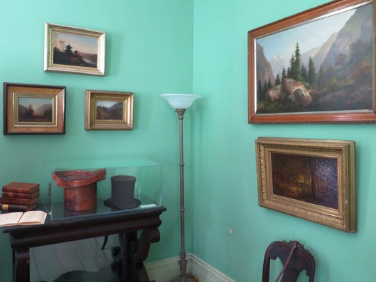 Paints by artist Cole are seen at his home in Catskill,