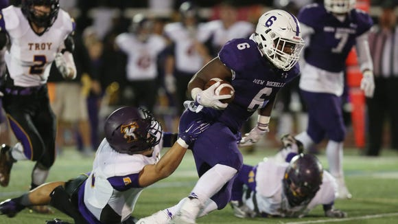 New Rochelle's Jared Baron (6) breaks away from a Troy defender on a first half run, during the state Class AA semifinal football game at Dietz Stadium in Kingston, N.Y. Nov. 19, 2016