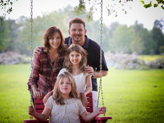 Jaimie, Shawn Baeckers with their daughters, Carlee and Skylar.