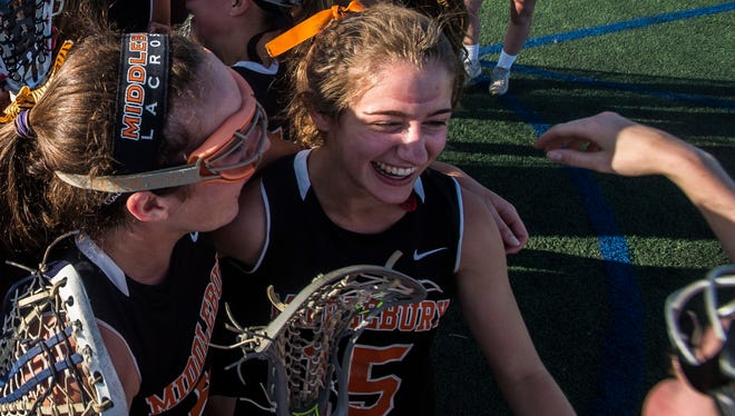 Middlebury's Andi Boe celebrates with teammates after winning the 2018 Vermont Div. 1 high school girl's lacrosse State Championship over CVU.