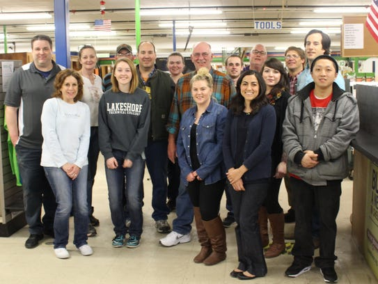 New employees of Sargento Foods pose for a photo after