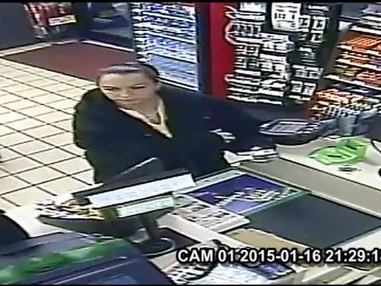 Screen capture of surveillance tape of one of two white females Staunton Police need held identifying in the connection to several incidents where counterfeit bills were passed.