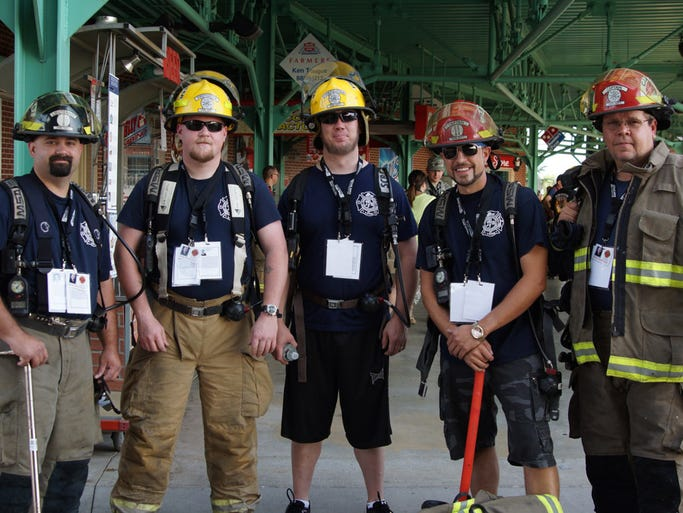 Travis Cramer, Tony Saitz, Trent Mall, Dave Hubbard and Rob Baker from Marshfield Fire Department, honoring fallen 9-11 firefighters; Salvatore B. Calabro, Robert W. Spear Jr., jonathan R. Hohmann, Richard A. Prunty, Thomas J. McCann, Michael E. Roberts, Richard J. Kelly Jr., Christopher P. Sullivan, and Douglas E. Oelschlager at the Springfield Area Memorial Stair Climb.  They were also climbing to honor fallen Marshfield firefighter Matt Blankenship who succumbed to injuries sustained during a July 13th fire.
