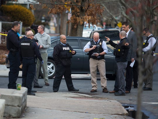 Wilmington Police investigate the scene of a shooting on the corner of North Pine and East 23rd Streets Thursday afternoon.