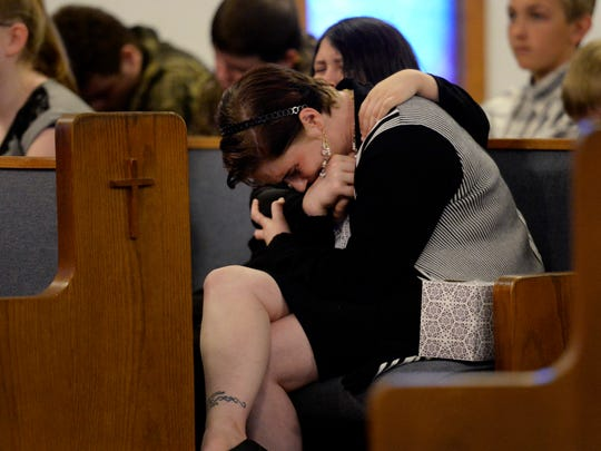 Dianna Ibarra is comforted by her daughter Roxanna Ibarra as they mourn during a community remembrance service for 5-year-old Joe Clyde Daniels at the Friendship Baptist Church Sunday, April 8, 2018, in Dickson Tenn. Daniels was reported missing and a countywide search ensued, but then authorities said the boy's father confessed to killing him.