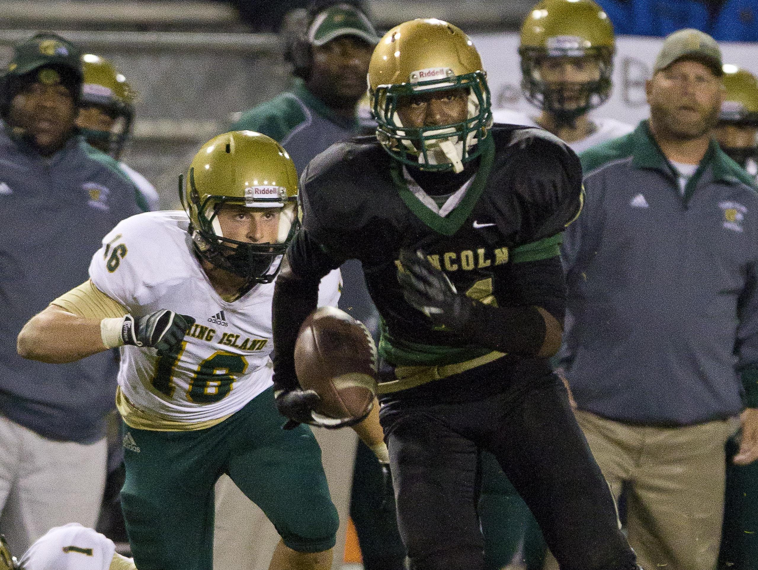 Former Lincoln star Taj Williams is pursued in a playoff game on November 16, 2012. Williams was recently named the top JUCO receiver in the nation and is committed to TCU.