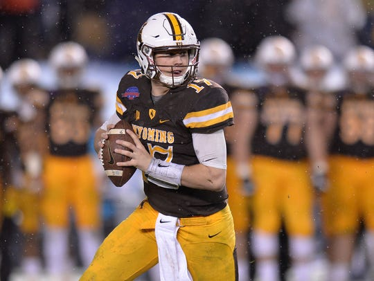 Wyoming quarterback Josh Allen, shown in last year's
