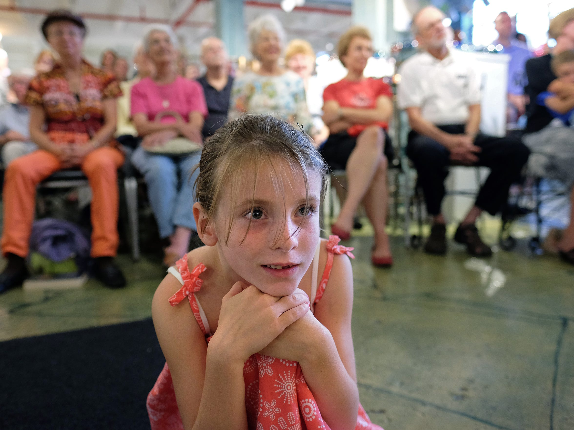 A young girl enjoys listening to a Heifetz concert last year at Sunspots Studios in Staunton.