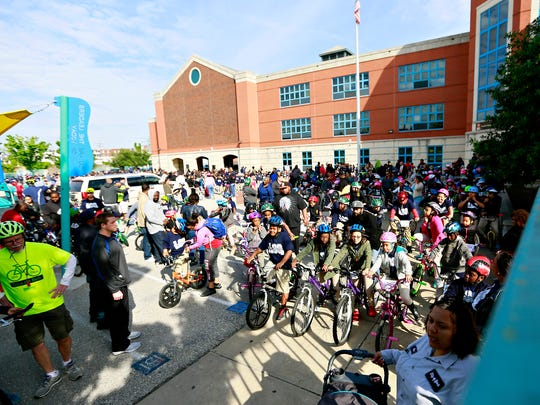 Lincoln Charter School students, faculty and families prepare to ride bikes and walk from the school to York City Hall in celebration of Bike to School Day in York City, Wednesday, May 10, 2017. Dawn J. Sagert photo