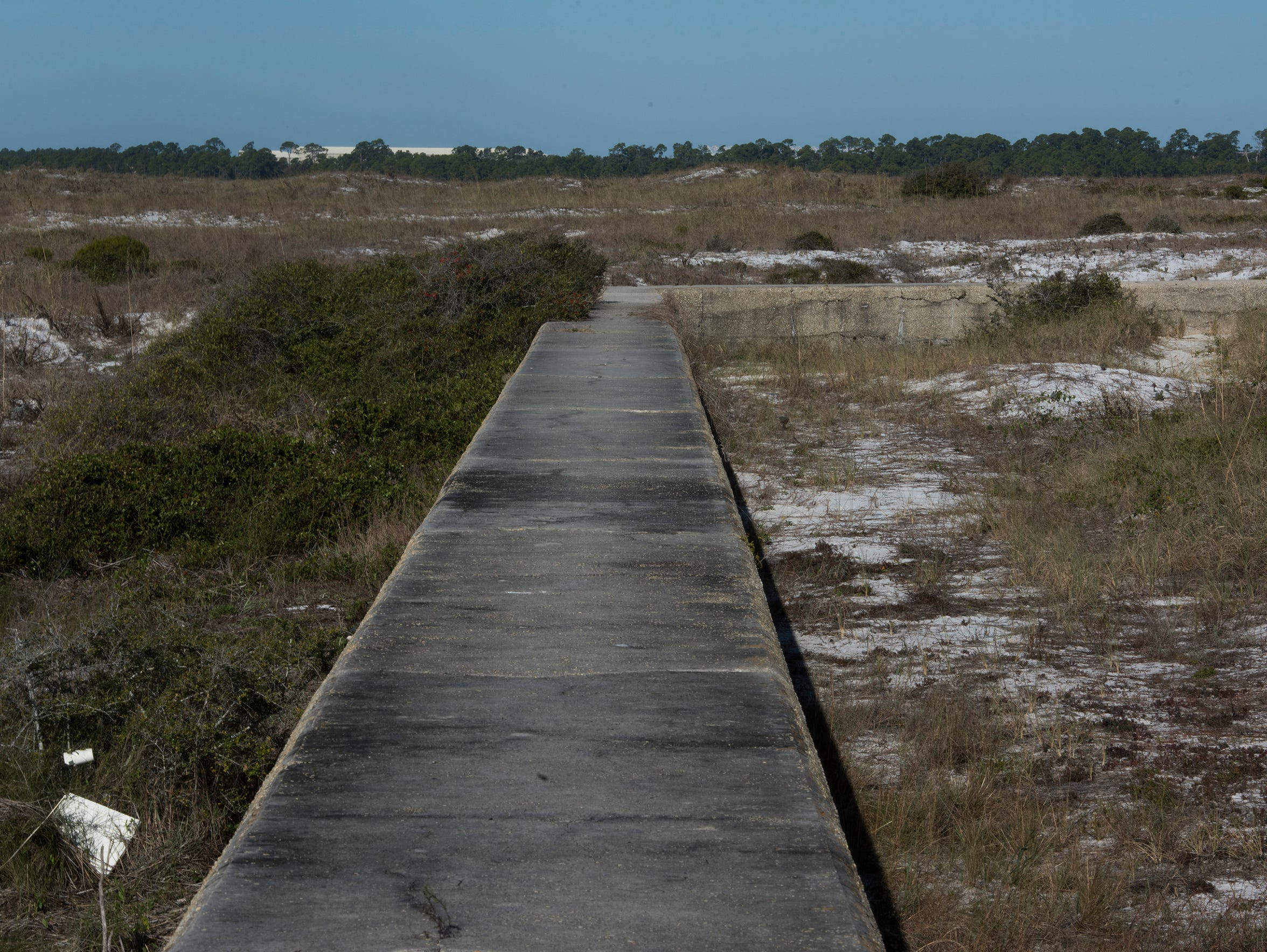 A seawall built in 1907 separates two dune areas on