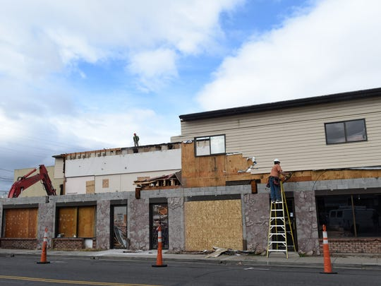 A demolition crew takes down the Maytan Music Center building on Cheney Street and South Center Street on Wednesday.