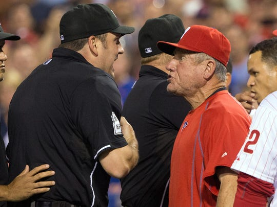 Philadelphia Phillies bench coach Larry Bowa is ejected by umpire Dan Bellino (2) after arguing a quick pitch by New York Mets relief pitcher Hansel Robles (not pictured) during the seventh inning at Citizens Bank Park. The Mets won 6-5. Credit: Bill Streicher-USA TODAY Sports