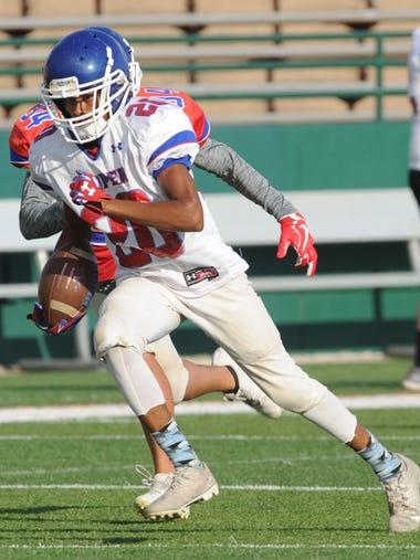 Cooper's Marcus Gomez (20) runs for a 33-yard touchdown