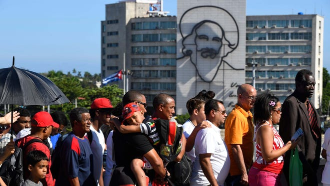 Thousands stand in line to pay tribute to Cuba's late President Fidel Castro in Revolution Square Tuesday.