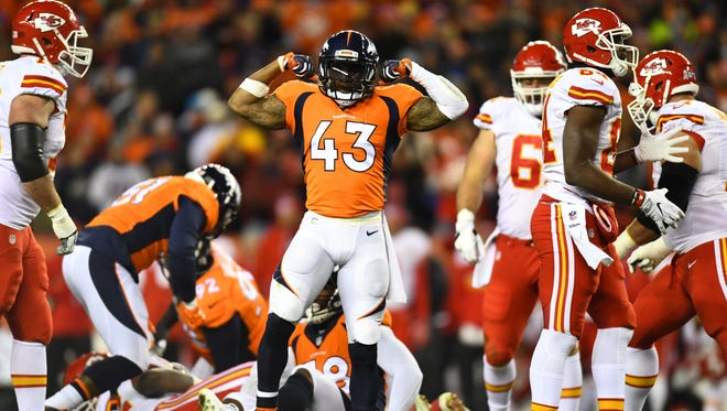 Nov 27, 2016; Denver, CO, USA; Denver Broncos strong safety T.J. Ward (43) reacts to a defensive stop in the first half against the Kansas City Chiefs at Sports Authority Field at Mile High. Mandatory Credit: Ron Chenoy-USA TODAY Sports