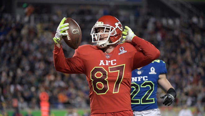 AFC tight end Travis Kelce (87), of the Kansas City Chiefs, runs into the end zone for a touchdown after catching a pass in front of NFC safety Harrison Smith (22), of the Minnesota Vikings, during the first half of the NFL Pro Bowl football game in Orlando, Fla., Sunday, Jan. 29, 2017. (AP Photo/Phelan M. Ebenhack) ORG XMIT: OTKPROB166
