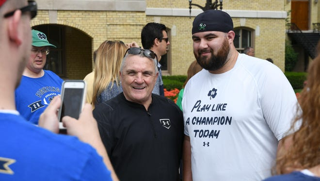 """Sep 24, 2016; South Bend, IN, USA; Mike Gabel of Akron, Ohio takes a photo with Daniel """"Rudy"""" Ruettiger before the game between the Notre Dame Fighting Irish and the Duke Blue Devils at Notre Dame Stadium."""