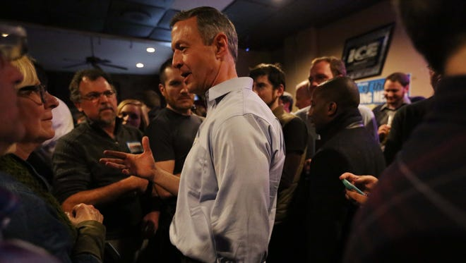Martin O'Malley shakes hands, takes selfies and talks with people in the crowd during a campaign event at the Des Moines dive bar, Carl's in Sherman Hill on Jan. 7, 2016.