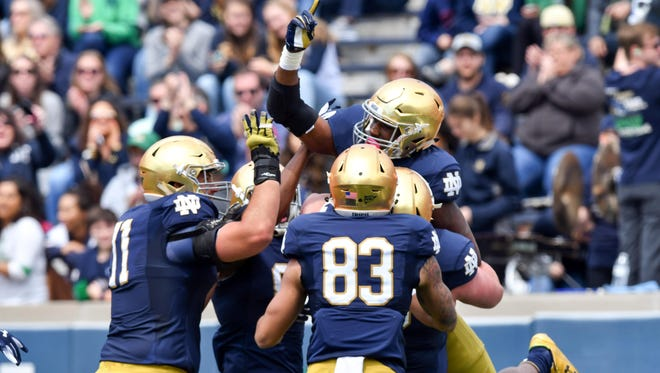 Notre Dame Fighting Irish running back Josh Adams (33) celebrates after a touchdown in the first quarter of the Blue-Gold Game at Notre Dame Stadium on April 22.