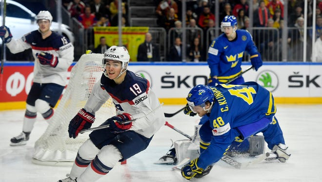 US forward Clayton Keller, left, just scored during the Ice Hockey World Championships group A match between USA and Sweden at the LANXESS arena in Cologne, Germany, Monday, May 8, 2017.