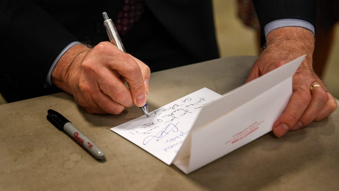 Human Health Services Secretary Tom Price signs a note which will be enclosed with pharmaceuticals, during a  tour of the Saint Thomas Health's Dispensary of Hope facility  in Nashville, Tenn., Tuesday, June 6, 2017.