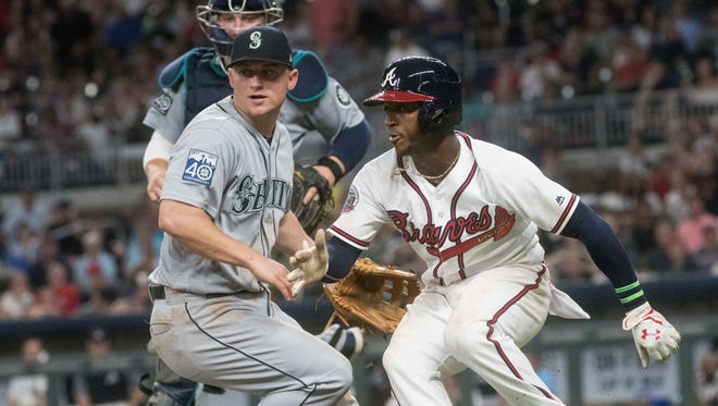 Atlanta Braves' Ozzie Albies (right) hits the brakes in a rundown as Seattle Mariners third baseman Kyle Seager defends during the sixth inning of Tuesday's game.
