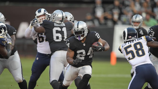 Raiders running back Marshawn Lynch (24) rushes against the Rams during a preseason game Aug. 19, 2017.