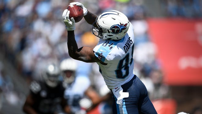 Tennessee Titans wide receiver Corey Davis (84) pulls in a first down catch during the first half against the Oakland Raiders on Sunday, Sept. 10, 2017, at Nissan Stadium  in Nashville.