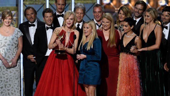 Nicole Kidman, holding Emmy, Reese Witherspoon, immediately to her left, and cast and crew of HBO's 'Big Little Lies' celebrate the limited series' Emmy win Sunday.
