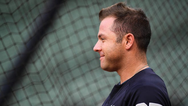 Yankees catcher Austin Romine looks on for batting practice during workouts at Minute Maid Park.