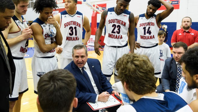 USI Head Coach Rodney Watson (center) strategizes with his team during a timeout in the second half against the Ohio Valley Fighting Scots in Evansville, Ind., Sunday, Dec. 31, 2017. The Screaming Eagles defeated the Fighting Scots, 95-69, in their last non-conference game of the season.