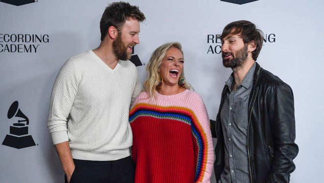 Charles Kelly laughs with his wife Cassie and David Haywood of Lady Antebellum as they walk the red carpet at Nashville's Nominee Grammy Party for the 60th Annual Grammy Awards at the  Loews Vanderbilt Hotel  in Nashville, Tenn., Thursday, Jan. 11, 2018.